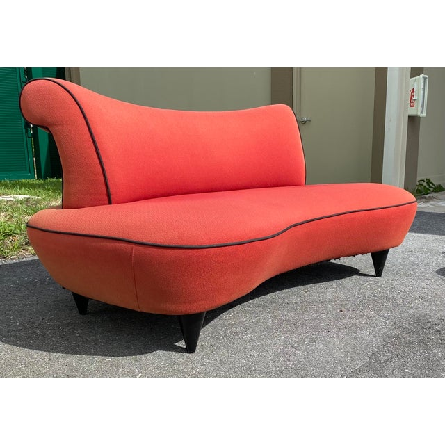 A very stylized Cloud shaped sofa with sculptural layered look in a very retro kidney shape with great back rolls...