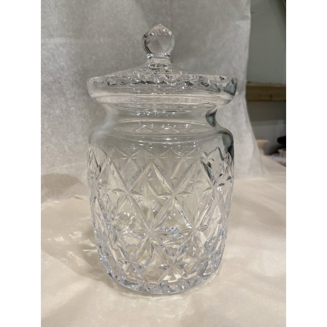 This is a beautiful vintage Tiffany & Co cut glass biscuit jar. It is signed on the bottom. It was difficult to...