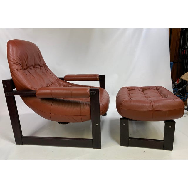 Percival Lafer Brazilian Lounge Chair with footstool. Great lounge chair made out of rosewood and leather. Also have...