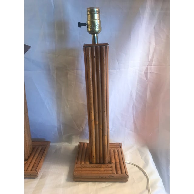 Pair of vintage pencil bamboo table lamps. -Wired with switch line -3-Way Brass Socket