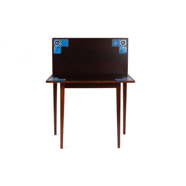 This folding rosewood and blue tile table by Illums Bolighus of Denmark is remarkably versatile as a game table or entry...