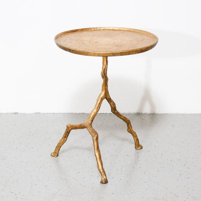 Lovely gilt iron branch form side table. Round top supported by a elegant branch shaped tripod leg.