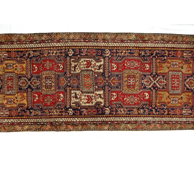 Wool pile hand woven vintage North West Persian runner in mint condition.