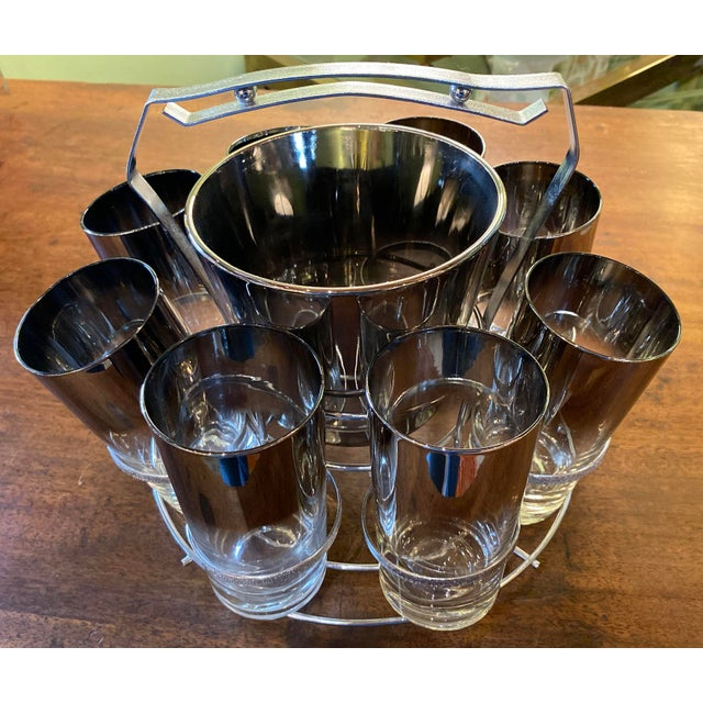 Serve up some fun with this retro Dorothy Thorpe eight glasses set with silver trim and a matching ice bucket in a...