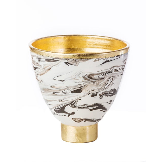 An elegant marble ceramic cachepot with gold leaf accents. Makes an impressive centerpiece or mantle accent piece.
