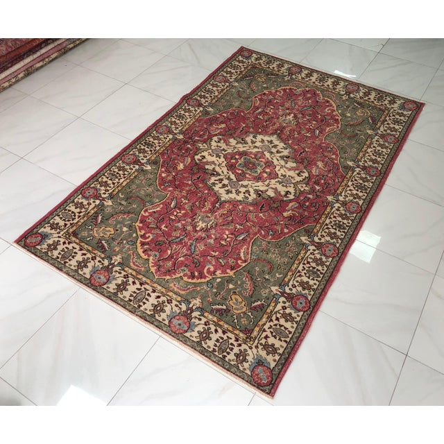 This is a vintage Turkish area rug. The piece was handmade in the 1970s.