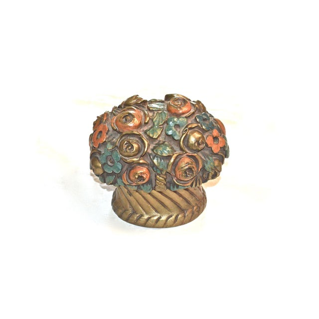 Vintage barbotine door stop, made in France. It has bronze cladding over a plaster core. It features a basket filled with...