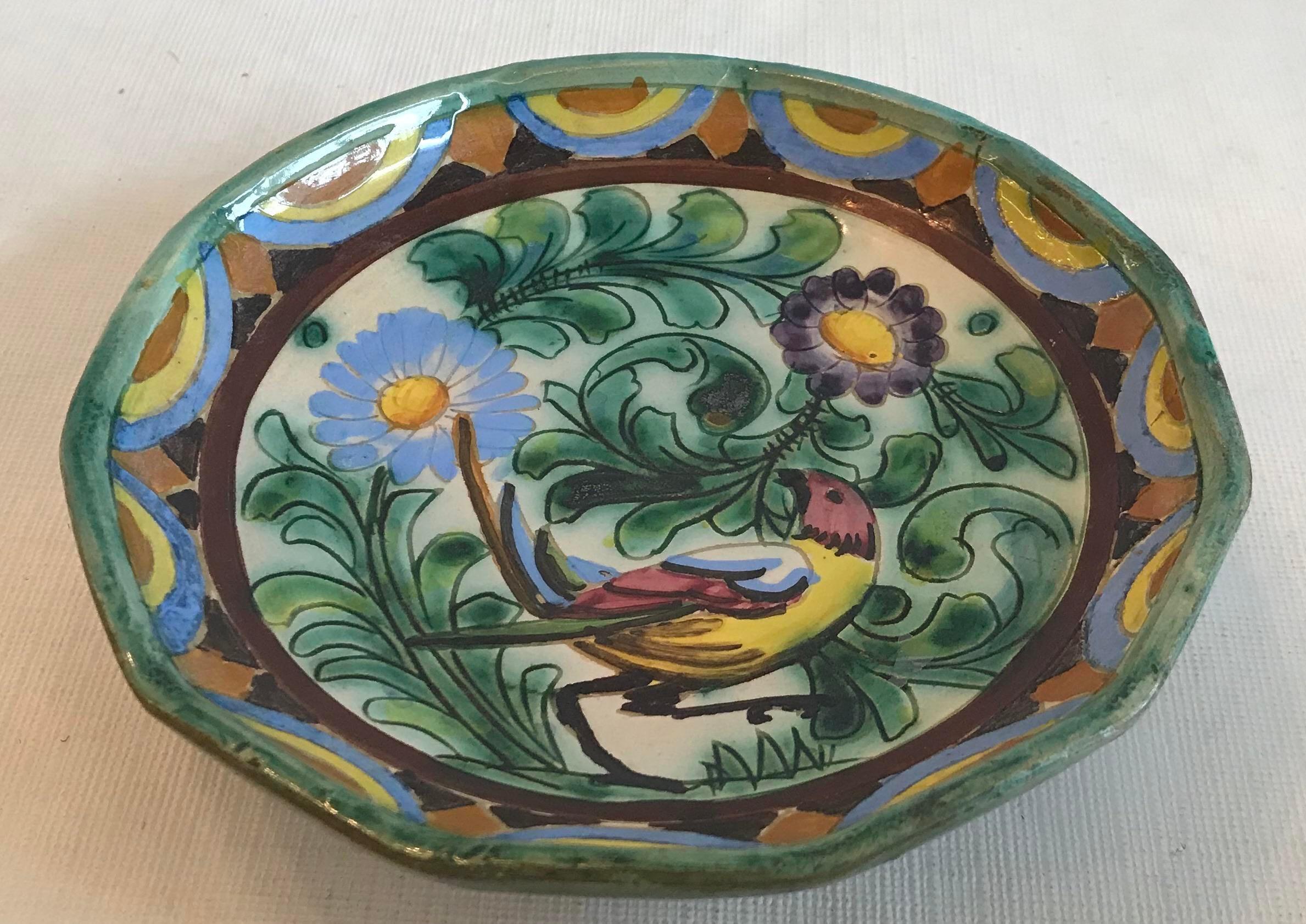 Signed pottery plate glazed bird beautiful