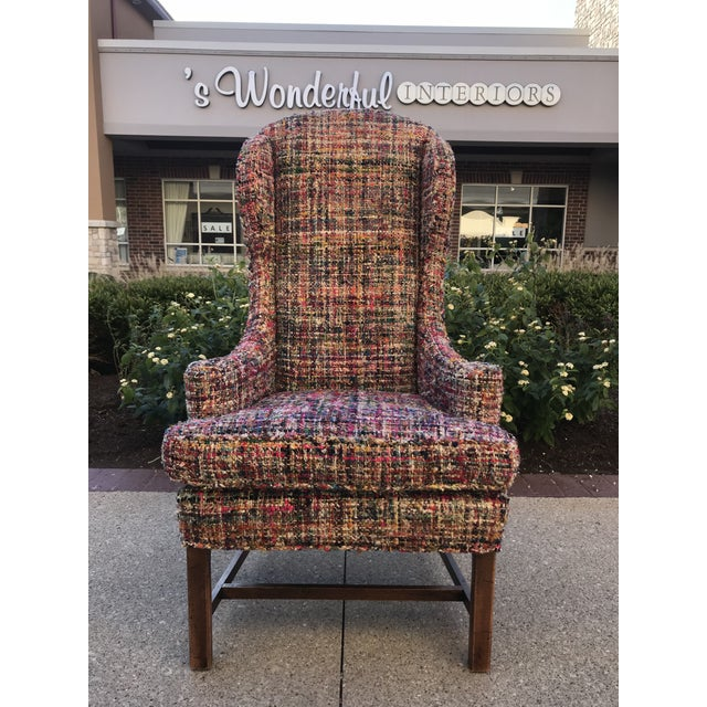 Pair of vibrant multi colored host chairs. Could be used fireside also. Fabric is similar to a Boucle or hand woven.