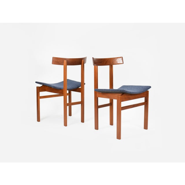 Danish modern set of 6 dining chairs designed by Inger Klingenberg for France and Son. The chairs feature a striking...