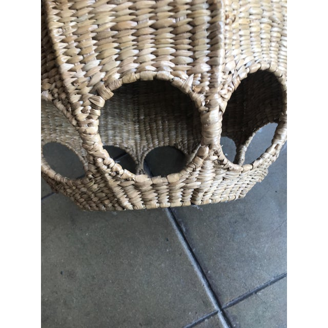 Handmade iron frame wrapped in reed, features peek a boo cutouts around the sphere, creates dramatic light.. Ceramic...