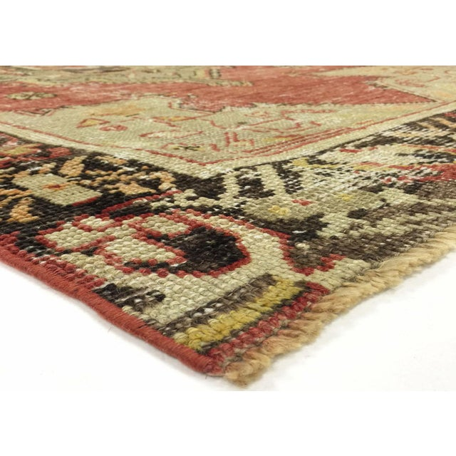 This Anatolian Rug was woven in the Anatolian region of Turkey in the mid 1960's. This unique vintage rug has a beautiful...