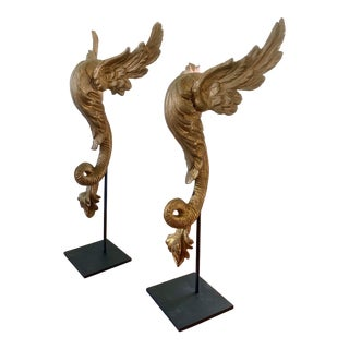 Antique Carved Giltwood Architectural Winged Fragments With Serpent Tails, Circa 18th Century For Sale