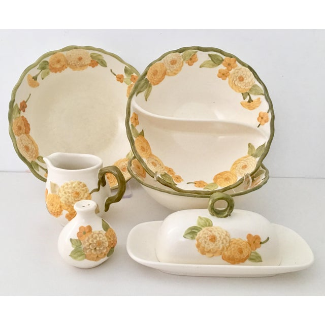 "1960s set of seven pieces in ""Sculptured Zinnia"" ceramic pottery dinnerware by, Metlox of California. ""Sculptured Zinnia""..."