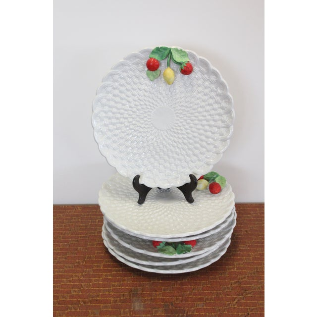 Set of 6 white painted porcelain plates with strawberry and lemon details.