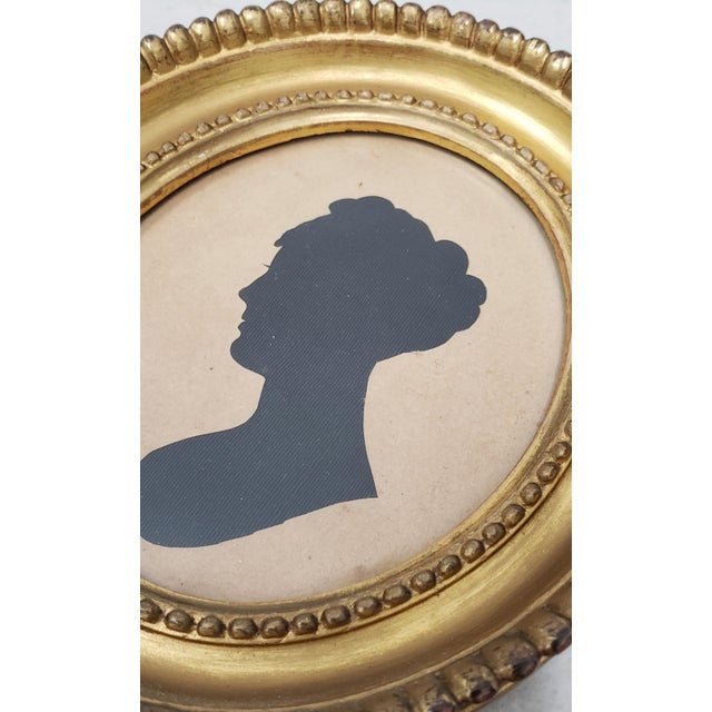 19th Century Silhouette Portrait of a Young Woman Charming little silhouette of a young woman in profile. There are some...