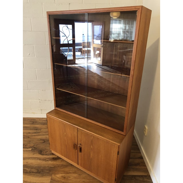 Danish teak cabinet with glass door display by Borge Mogensen for Soborg Mobler, made in 1961. This is a high quality...