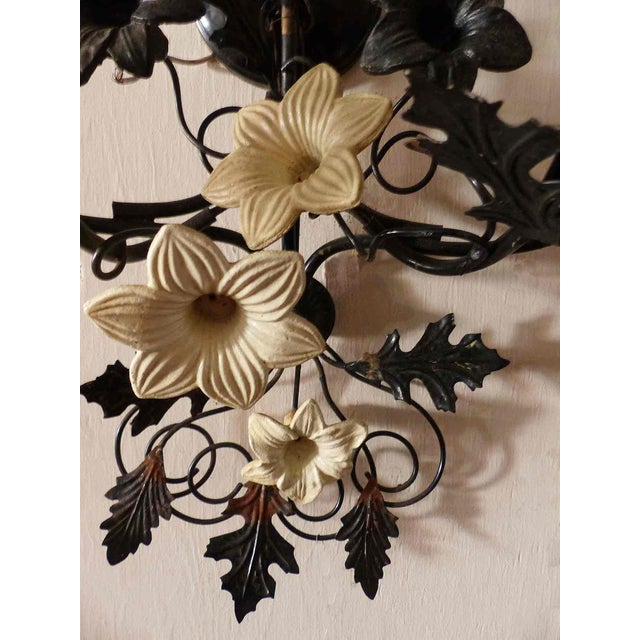 1930's Italian black painted metal with tole floral sconce. Four available, priced individually.