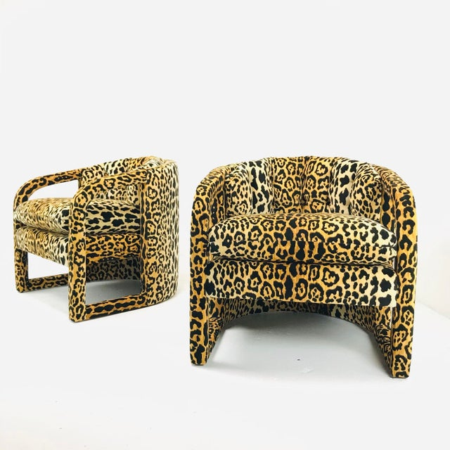 Gorgeous pair of barrel-back cutout armchairs in custom leopard velvet. Made to order and can be modified to your...