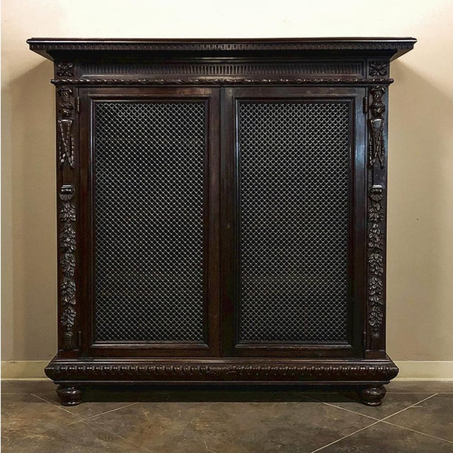 19th Century Italian Neoclassical Walnut Barrister's Bookcase features hand-sculpted brilliance in a compact package that...