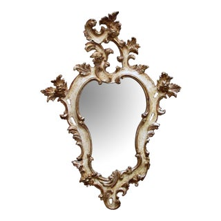 A Fanciful Venetian Rococo Revival Ivory Painted and Parcel-Gilt Cartouche-Shaped Miror