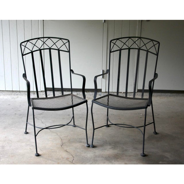 Salterini style pair of patio chairs in black iron. Great detail to the backs and arms of the chairs. Very sturdy and...