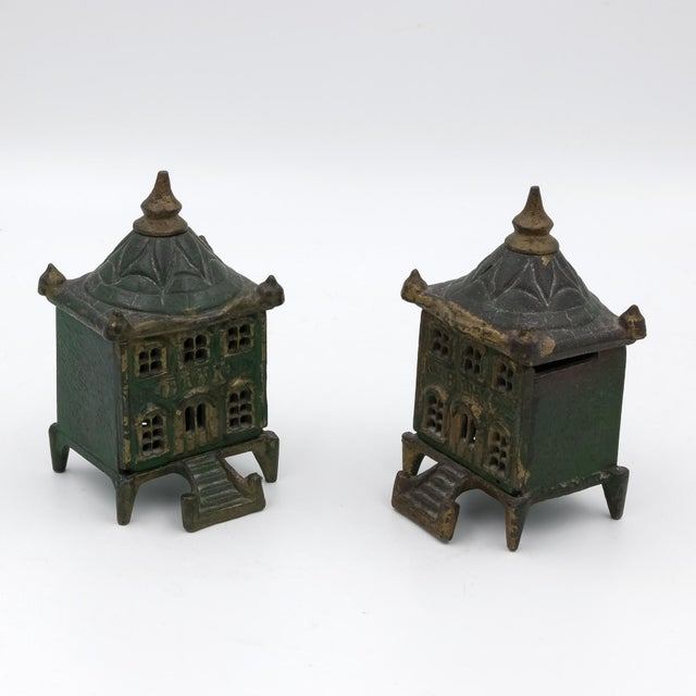 A Pair of antique painted cast iron coin architectural still banks with most of their original green paint; English circa...
