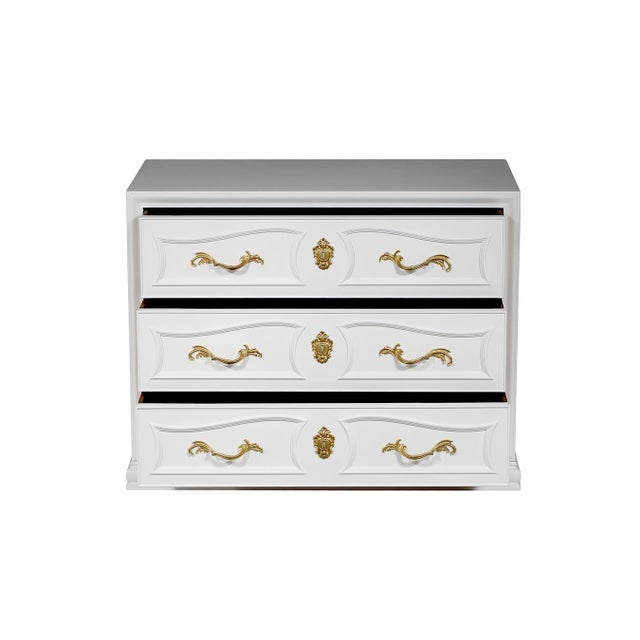 Pair of vintage French-style Henredon chests newly lacquered in white with brass hardware and three drawers each.