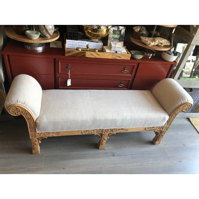 Beautifully carved wooden bench with scroll arm detail and newly upholstered in Mark Alexander natural linen. Enjoy the...