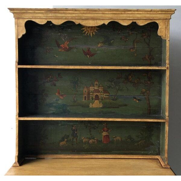 19th-C. Continental cupboard with painted design in the top half. Height: 72.5″ Width: 42.5″ Depth: 19.5″