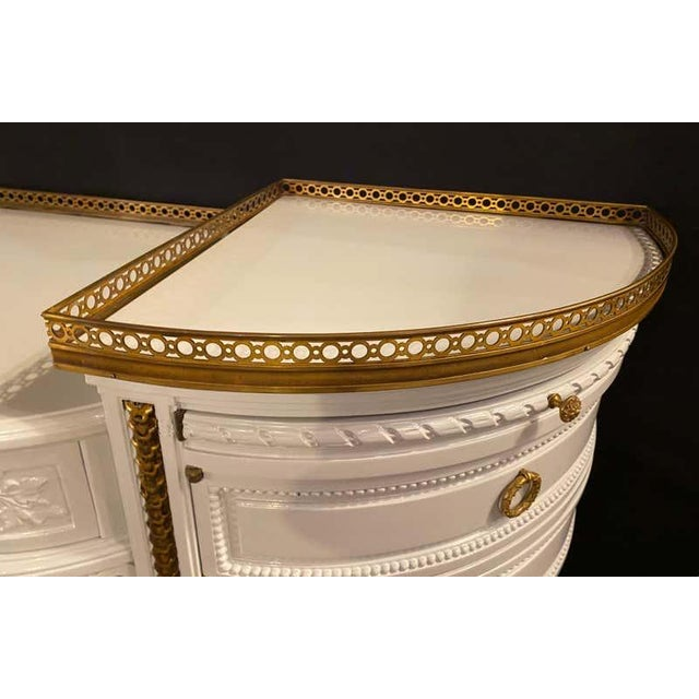Louis XVI style ladies vanity / writing desk in dove gray lacquer and parcel-gilt gold finish. This spectacularly bronze...