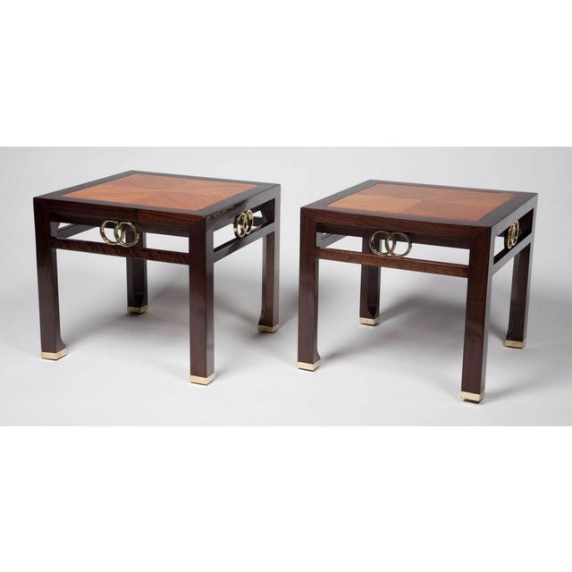An elegant pair of square occasional tables, from the Far East collection by Baker, in dark stained walnut with inlays of...