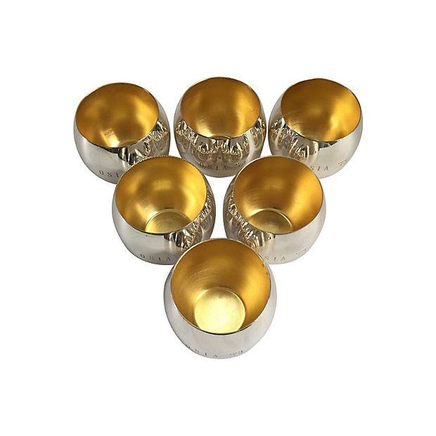 """Set of six 1970s monogramed silver-plate roly poly glasses with goldtone interiors. Monogrammed, """"OSIA, '73."""" Marked..."""