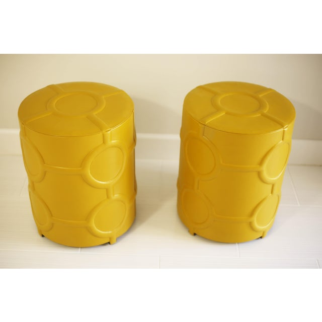"Cylindrical, mustard yellow leather side tables from Global Views. Made in India. Sold seperately. 20"" tall x 16.5""..."