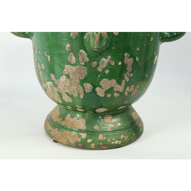 This is a lovely green glazed planter from Anduze, France with four handles and a footed base. The beautiful green glaze...