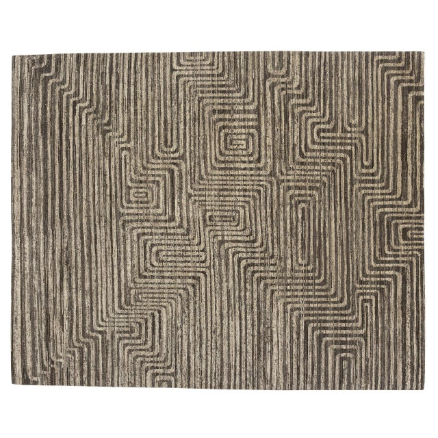 Carefully selected undyed lots of Himalayan wool create the contrasting bands in this design. The material's natural...