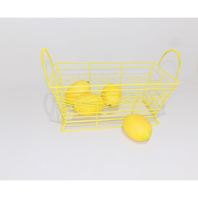 Adorable little rack perfect for a bathroom counter to display all your items. Cute yellow color. Item is vintage metal...