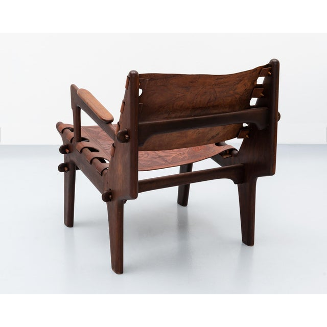 A lounge chair and ottoman by South American modernist Angel Pazmino for Muebles de Estilo in solid rosewood with heavy,...