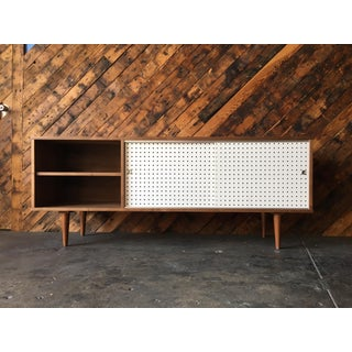 Custom Walnut credenza with perforated doors and metal track Preview