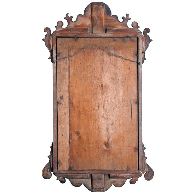 Chippendale style mirror with cut edge details. Restored & finely painted in red wash. Retains the look of an antique...