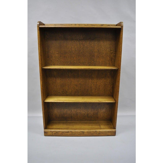 Beautiful wood grain, 2 adjustable shelves, great form and function. Made of oak in America in the mid 20th century....