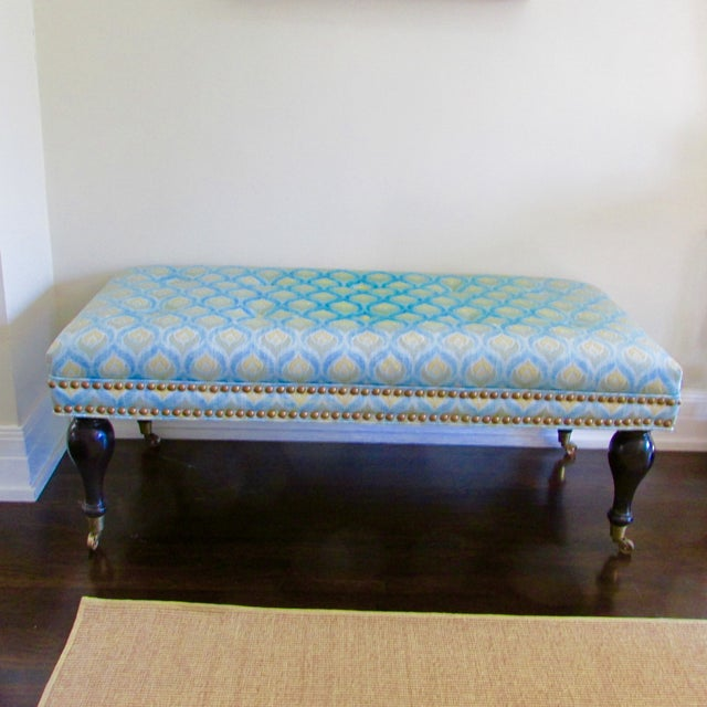 Custom upholstered bench with subtle tufting and casters on feet. While barely used it sat in a sun room so there is some...