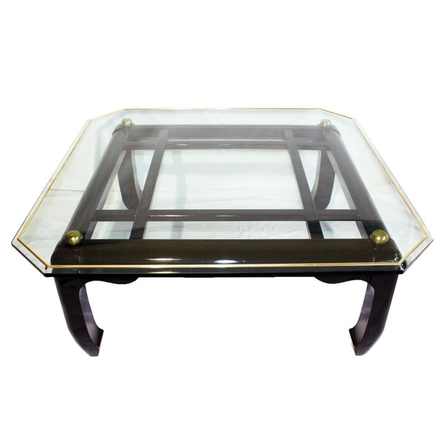 Stunning Ming-style Chinoiserie coffee table with gold brass & black lacquered wood base featuring fretwork detailing....