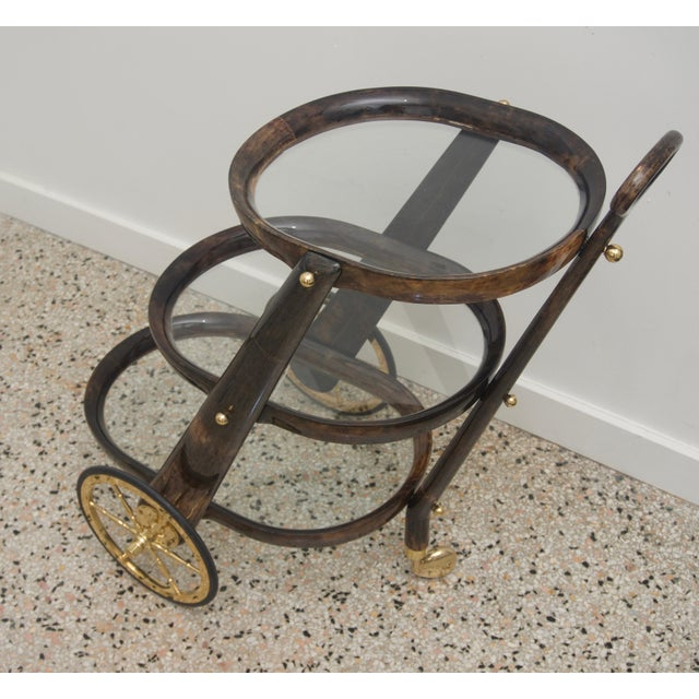 This stylish Aldo Tura bar cart is one of the rarer forms to come across and this one was acquired from an estate on...