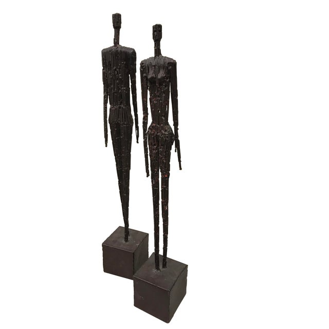"""A wonderful addition to any room this contemporary pair of metal figures of man and woman on bases. - Measure Man-27 1/4""""T..."""