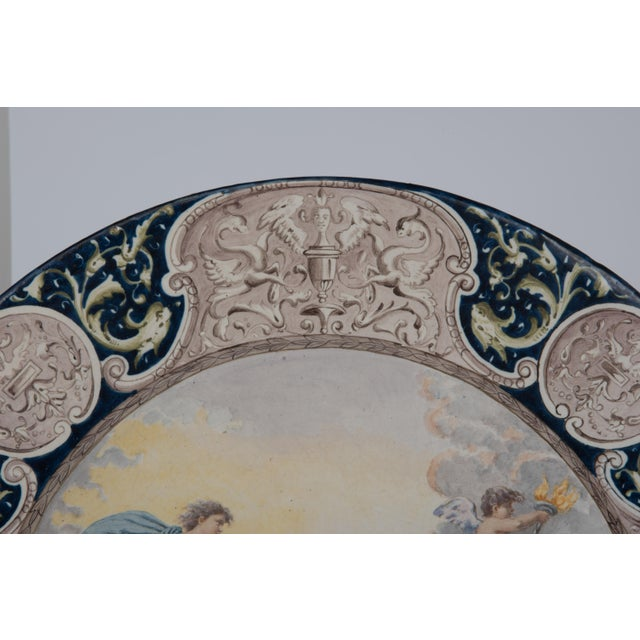 A large 24 inch diameter hand painted faience charge in the manner of Deruta, Italy, 19th Century. The cobalt blue border...