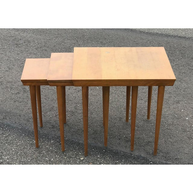 Beautiful minimalist nesting tables made of solid birch wood designed by Russel Wright for Conant Ball. All three tables...