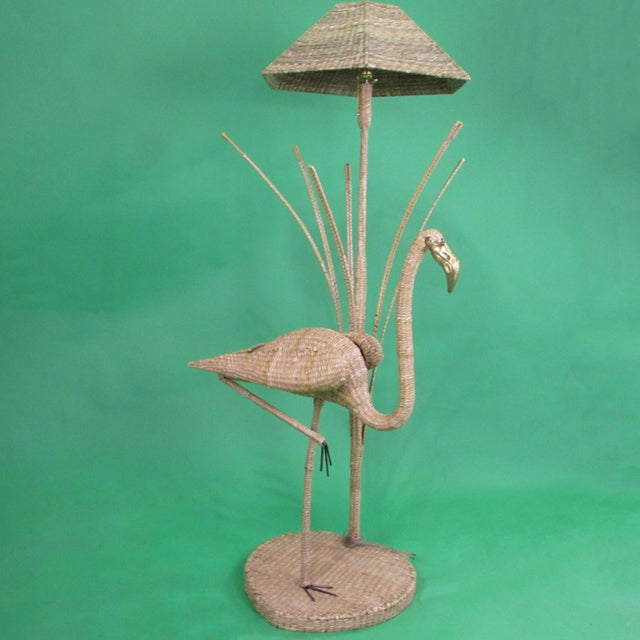 Woven Rattan Flamingo w/Reeds Floor Lamp by Mario Lopez Torres in nice as found condition. There are minor scuffs to the...