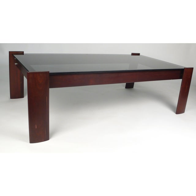 Percival Lafer coffee table in Jacaranda rosewood with original smoked glass top.