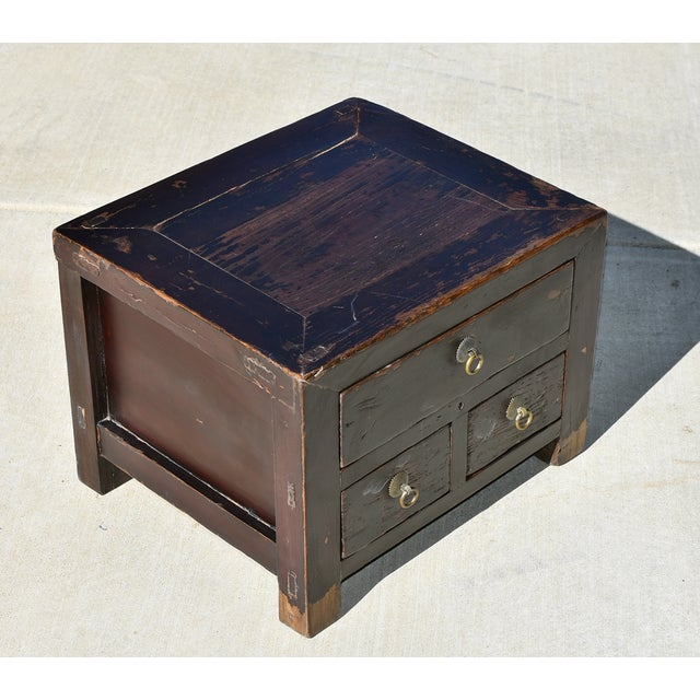 An antique Chinese chest, small but very heavy, solid and substantial. This is a northern Chinese piece that is used to...